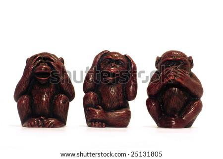 three wise monkeys isolated on white - stock photo