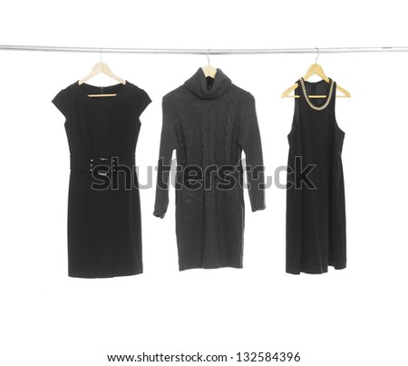 Three woman black clothes on a hanger - stock photo