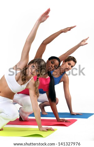 Three woman in gym class - stock photo