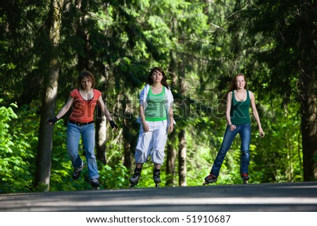 Three woman rollerskating - stock photo