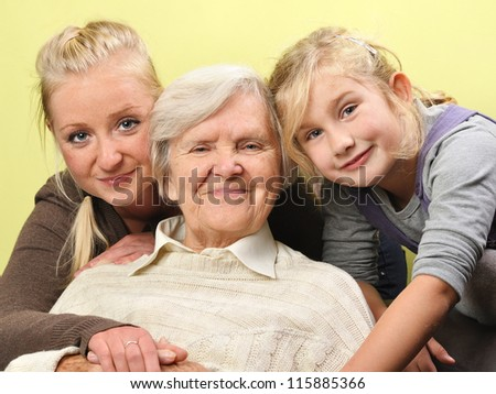 Three woman - three generations on white. MANY OTHER PHOTOS WITH THIS FAMILY IN MY PORTFOLIO. MANY OTHER PHOTOS WITH THIS FAMILY IN MY PORTFOLIO. - stock photo