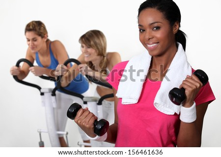 Three women at the gym. - stock photo
