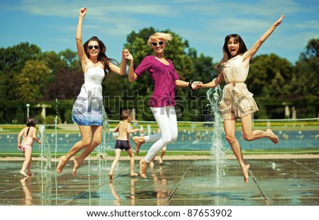 Three women enjoying summer day - stock photo