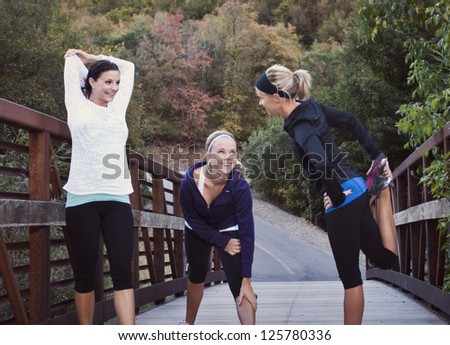 Three women getting ready for a Run - stock photo