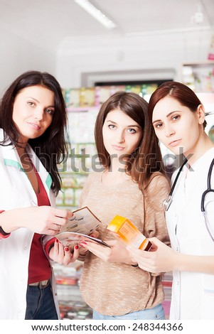 Three women in pharmacy. One is a doctor, other is client and the third one is a pharmacist. Healthcare. Business in healthcare. Healthcare business. Medicine. Pharmaceutical - stock photo