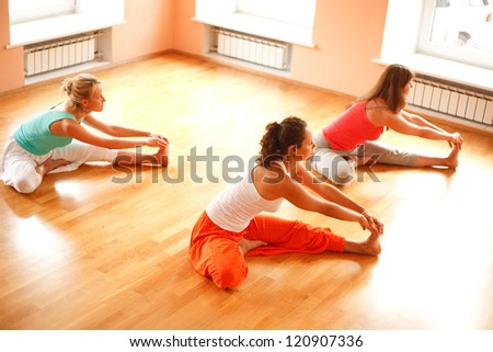 Three women is doing yoga at health club.High angle view - stock photo