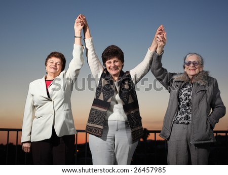 Three women raising hands - stock photo