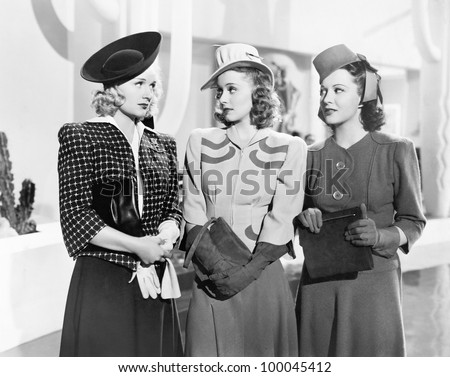 Three women standing side by side - stock photo