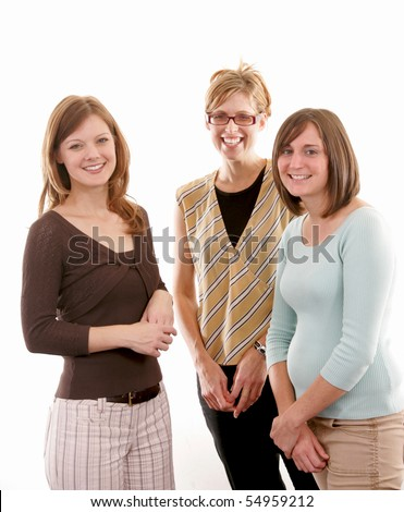 Three women standing together and smiling - stock photo