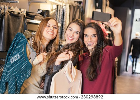 Three Women Taking a Selfie while Shopping - stock photo
