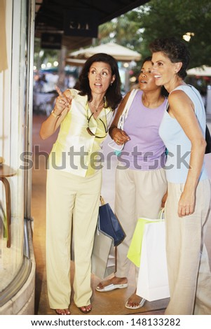 Three women window shopping