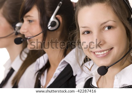 Three women working in the office - stock photo