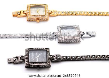 three women wrist watches on a white background - stock photo