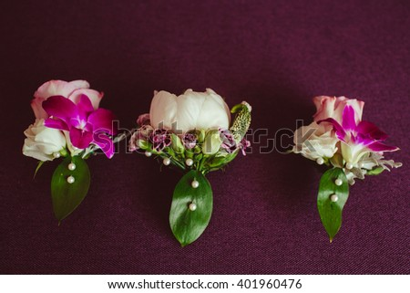 three wonderful beautiful flowers on the table - stock photo