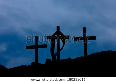 three wooden crosses and clouds - stock photo