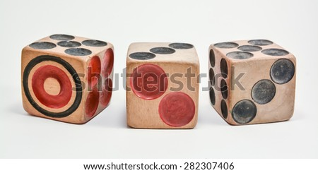 Three wooden dice on white background - stock photo