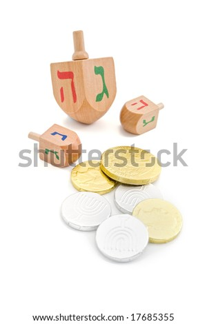 three wooden dreidel and chocolate coins - gelt Jewish Hanukkah game isolated on white - stock photo