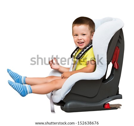 three-year-old boy sits in an automobile children's chair, isolated, on the white - stock photo
