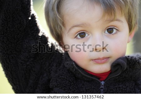 Three year old portrait of innocence outdoor in the sunlight - stock photo