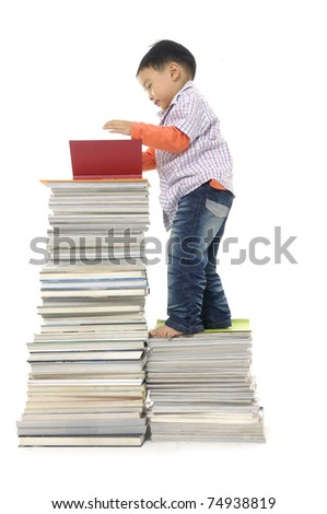 Three years old boy reading book on white background
