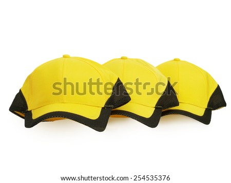 three yellow baseball caps with black field isolated on white, studio shot - stock photo