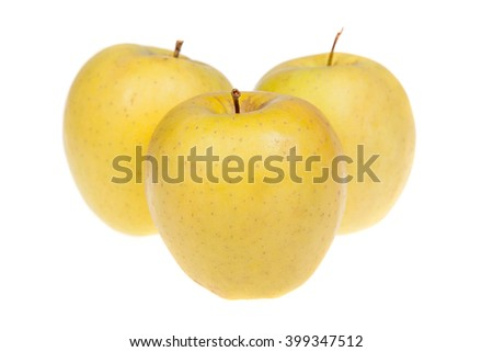 Three yellow delicious apple fruits, isolated on white background - stock photo