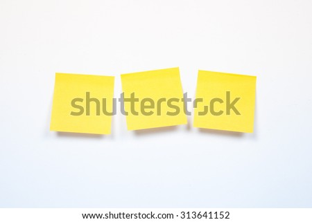 three yellow sticker on a white background, blank yellow adhesive note on white background with shadow - stock photo
