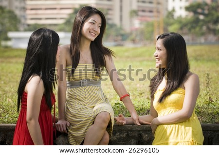 three young and pretty lady friends together