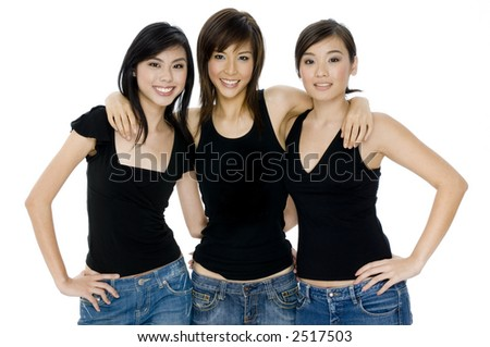 Three young attractive asian women in black tops and jeans on white background