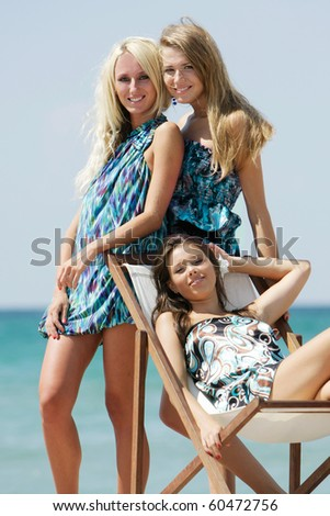 three young beautiful girls on beach - stock photo