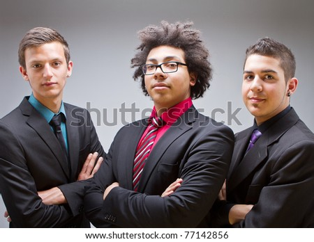 Three young businessman posing at the camera. Trendy and Cool. - stock photo