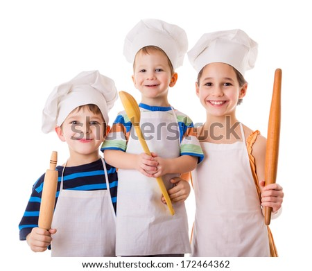 Three young chefs with ladle and rolling pin, isolated on white