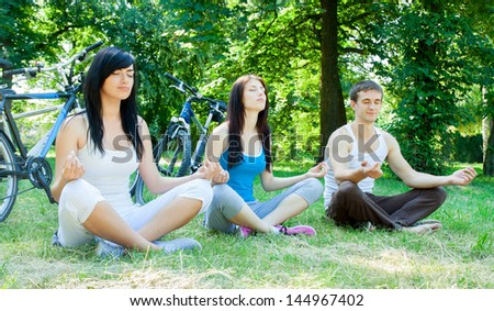Three young cyclists meditate on the nature of - stock photo