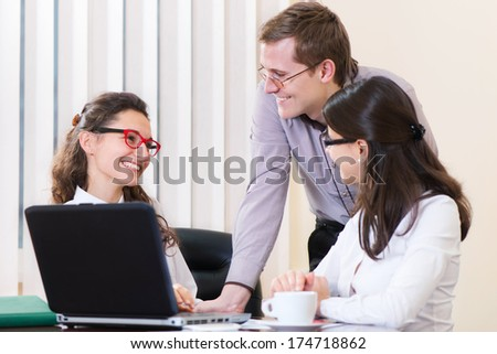 Three young executives working at modern office - stock photo