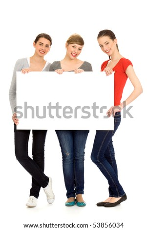 Three young girls holding blank sign - stock photo