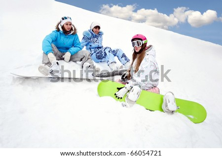 Three young girls sit on the bottom of the mountain - stock photo