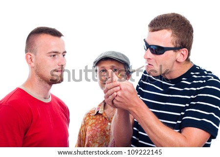 Three young guys going to smoke hashish joint, isolated on white background.