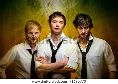 Three young handsome guys - stock photo