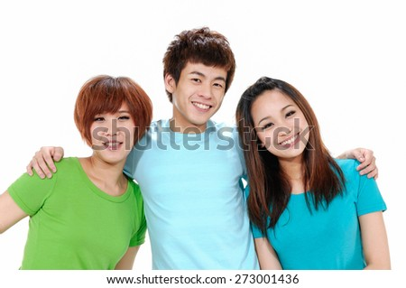 Three young happy friends. Two girls one boy smiling - stock photo