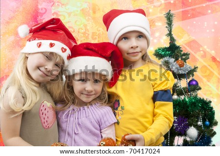 three young little caucasian blond girls standing together near christmas tree holding gifts and smiling sincerely.isolated on colorful  background