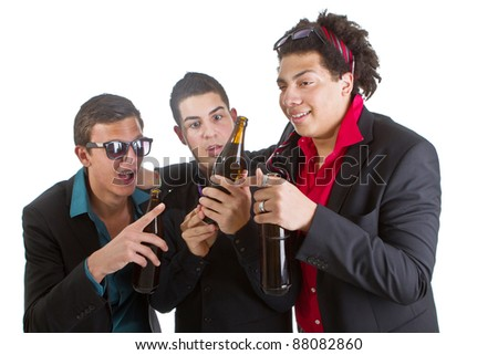 Three young men with business outfit with beer isolated over white. - stock photo