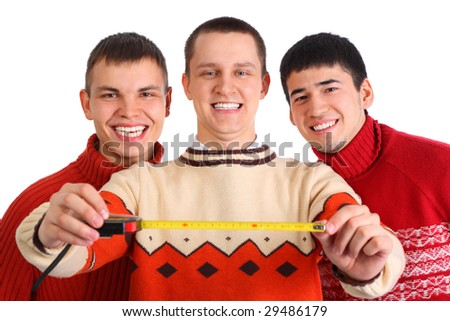 Three young men with tape measure
