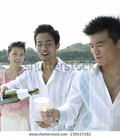 Three Young People at Yacht Party - stock photo