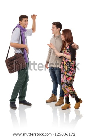 Three young people discussing about something fun - stock photo