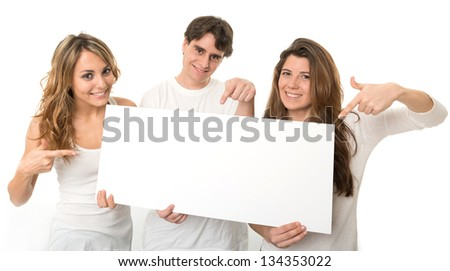 Three young people holding a blank sign, ideal for inserting your own message - stock photo