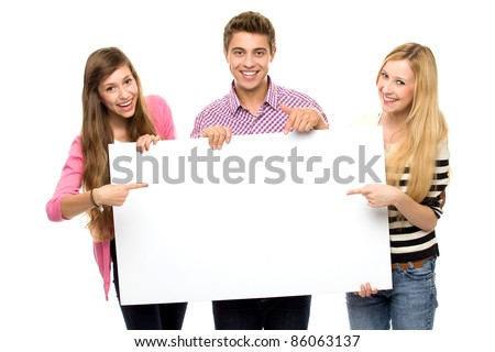 Three young people holding blank poster - stock photo