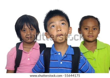 Three young students with books, folders and rucksack for school. - stock photo