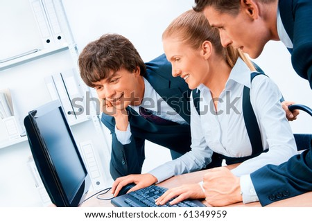 Three young successful businesspeople. Screen has a clipping path. - stock photo