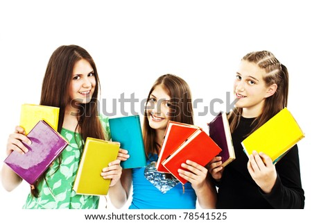 Three young teenage girls with colored books - stock photo