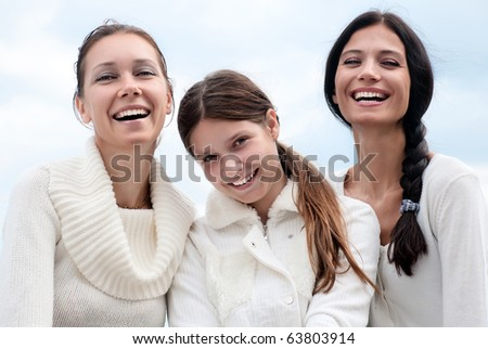 Three young woman enjoying autumn - stock photo